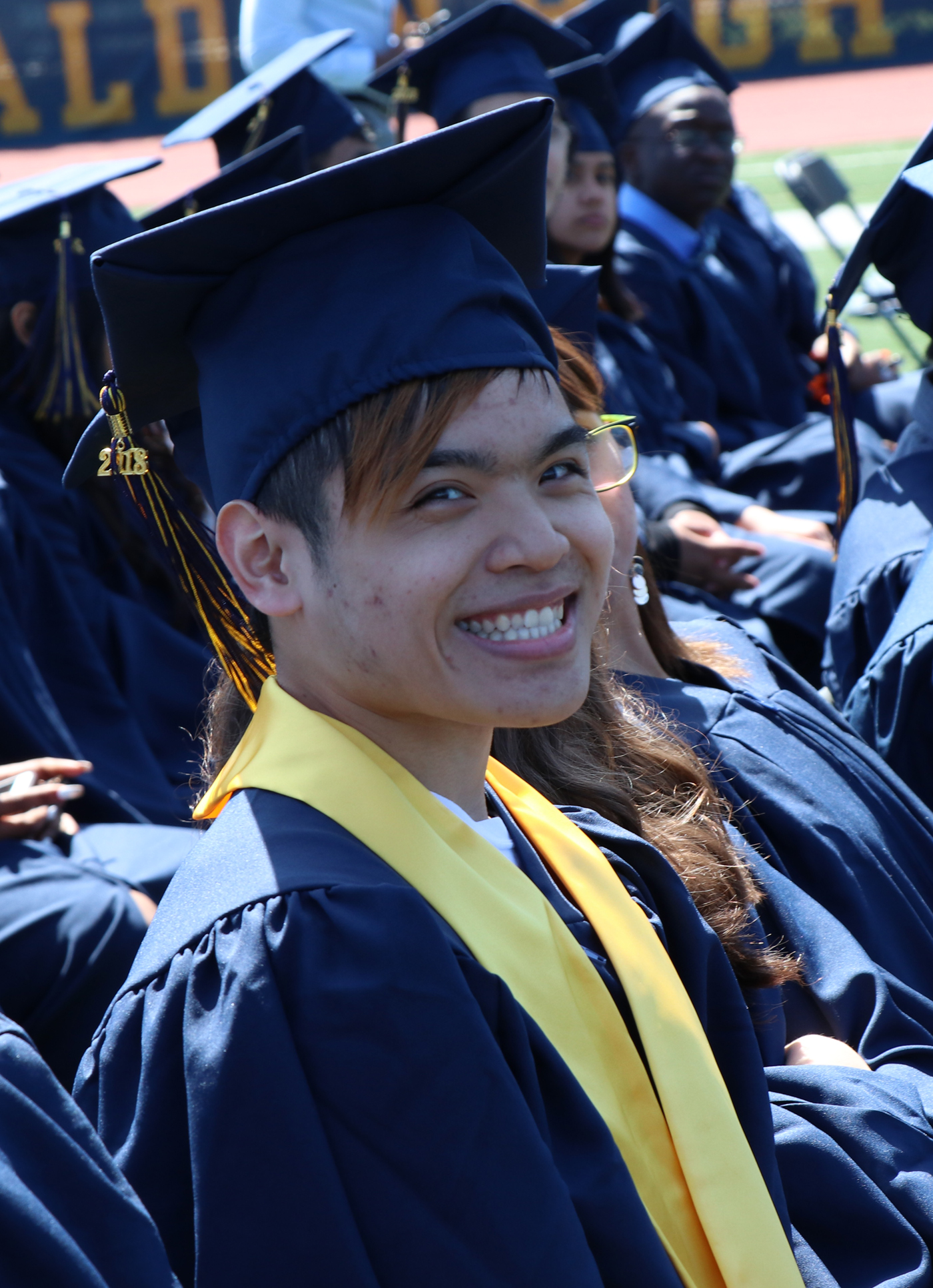 Graduate Jimmy Tran is the first to graduate from MHS with an Associates Degree from Bunker Hill Community College at the same time
