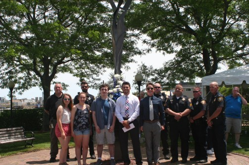 THIS YEAR'S AWARD RECIPIENTS: The Officer Harold L Vitale Memorial Fund awarded six $1,000 scholarships to local high school students last Saturday at Vitale Park in Saugus. The Students who were honored include, left to right: twin sisters MacKenzie Lee and Madison Lyn Cunningham, of Revere High School; Jack Wayne Elam, Revere High School; Ricardo Alberto Martinez-Moretta, Saugus High School; Matthew Samuel Zichella, Winthrop High School. They are joined by parents and members of the Saugus Police Department. Missing from photo and unable to attend was Michael Chankhour, of Wakefield High School. (Courtesy Photos to The Saugus Advocate)