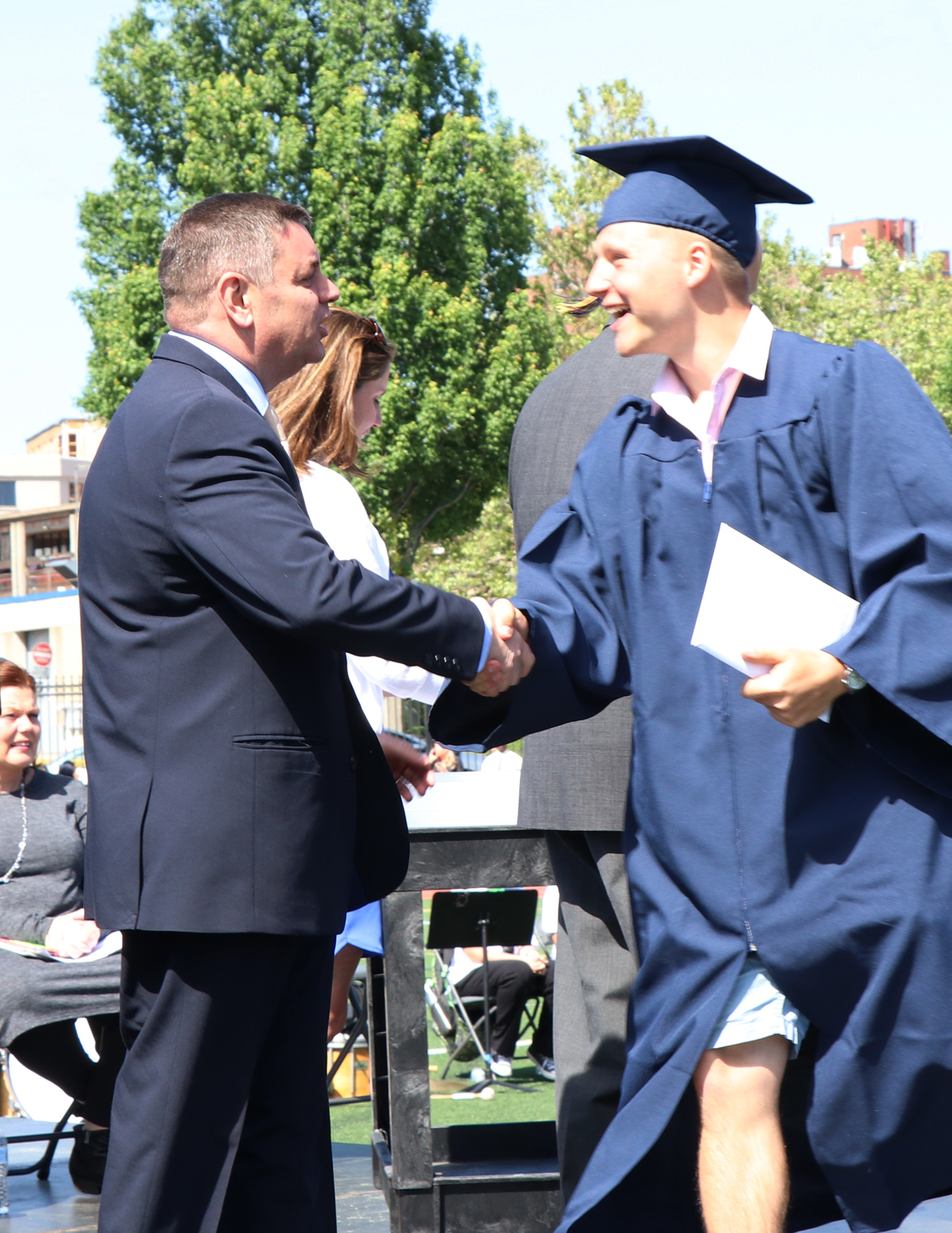 Superintendent Jon Oteri presents Michael Goroshko with his diploma.