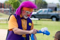 Silly Willy the clown entertained the kids as he created various balloon creatures to hand out