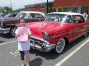 """Alexis Comeau with many of the cars on display at the Mom's Cancer Fighting Angels """"Car Show Cruise Night"""""""