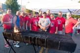 City workers worked tirelessly to grill throughout the afternoon to keep up with the demand for burgers and hot dogs
