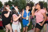 Janelle Eugene, Renee Betts-Augustin, and Lily Nguyen danced throughout the late afternoon as they waited for fireworks to begin