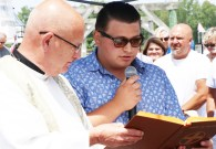 James O'Donnell reads a scripture during the blessing ceremony.