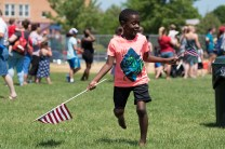 Kyllian Mahatoo frolicked through the field while proudly waving the American Flag