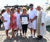 State Representative RoseLee Vincent presented a citation from the House of Representatives from her and Speaker Bob DeLeo. Shown from left; Assistant Vice Commodore Jill Simmons-Wetmore, Sophia Forgione (from Speaker DeLeo's office), Assistant Commodore Jay Bolton, Representative Vincent, Commodore Jack Glancy and Father Richard Uftring.