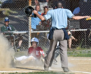 Christian Delgado of Everett is called safe after sliding into home plate during their Little League District 12 game 6-2 loss to Medford at Gillis Park in Medford on Thursday, July 12, 2018.