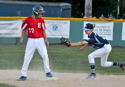 Andrew Crasco of Everett stands on second base as Cam Flaherty of Medford misses the tag during their Little League District 12 game 6-2 loss to Medford at Gillis Park in Medford on Thursday, July 12, 2018.
