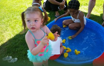 Haylee Baker, 3, found a cool spot with the ducks in the wading pool at Forestdale Park.