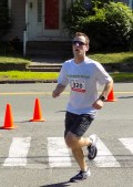 Alan Howsare, 30, of Malden, crosses the finish line at Town Hall during the 51st Annual Fourth of July Road Race.