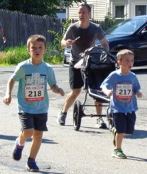 Grant Hudson (left), 6, and Luke Hudson, 4, both of Lynnfield, ran in the 51st Annual Fourth of July Road Race. (Photos Courtesy of The Lynnfield Athletic Association)