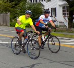 Participants of the 14th Annual Reid's Ride to Fight Adolescent and Young Adult Cancer ride through Manchester-by-the-Sea along Route 127 North on July 15.