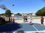 Children participating in a foul shooting competition during the Fourth of July festivities at Raddin Park.
