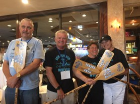 From left to right, Rick Foley of Revere and Kevin O'Malley of Revere – the Wild Irish Rowers – and Mary Jones and Cheryl Crawford of Mary & Cheryl, won the canoe race during Saturday's competition. (Photos by Tara Vocino)