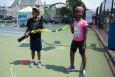 Jonathan Yilkal and Miykai Sampson posed with a giant tennis racket at Devir Park on Tuesday as they waited to compete in a friendly match.