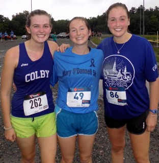 Margo Buys, 20, Maggie Hojlo, 23, and Katie Metayer, 23, were among the nearly 200 runners who braved torrential downpours Sunday to participate in the Fourth Annual Mary O'Donnell 5K to continue raising money in the fight against amyotrophic lateral sclerosis (ALS). (Advocate photo by Christopher Roberson)