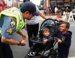 Sergeant John Perez of the Revere Auxiliary Police Dept. talks with Franklin Munoz and his brother on their way in to the festival.