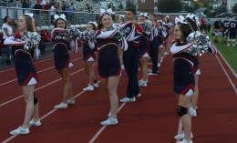 The RHS Patriots Cheerleaders led the fans to cheering on their team.