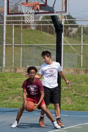 Caleb Awlachew and Adam Marshall competed in the 3-on-3 basketball tournament at Florence Street Park.