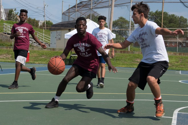 Rodney Mendes raced through the court against his opponents in the 3-on-3 basketball tournament on Saturday.