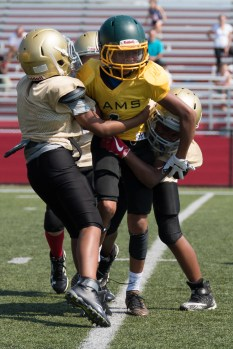 Everett Pop Warner went in for the tackle against West Lynn on Sunday afternoon.
