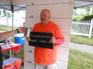 "I'M INNOCENT! Selectman Jeff Cicolini gets his mug shot taken as he is ""booked-in"" at the SAUGUS BAND-ITS JAIL."