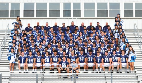 The Peabody Tanners football team, coaches and cheerleaders.