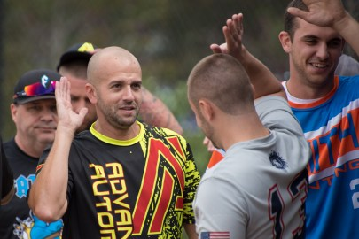 Dave Chalifoux high-fives opponents after a round of softball