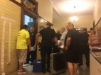 Police officers and poll workers wait for the election results inside City Hall on Tuesday night.