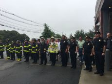 Police and fire officials held a moment of silence during Tuesday morning's 9/11 remembrance ceremony at the Public Safety building on Revere Beach Parkway.