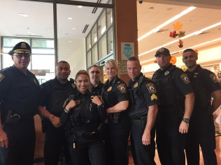 From left to right, Chief James Guido, Officer Jorge Romero, Officer Brendan Galvez, Capt. Steve Ford, Capt. Amy O'Hara, Sgt. Dave Pressly, Officer Randy Cipoletta, and Officer Elalam Younis talked to citizens about past and current experiences with police in Wednesday morning's Coffee with a Cop at Market Basket Cafe.
