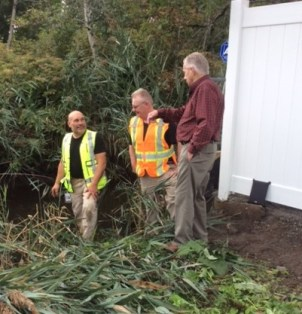 Ward 5 Councillor John Powers makes a site visit, as city employees prepare to take soil samples from the Eastern County Ditch in Revere. This ditch is going to be cleaned to help with flooding problems. (Courtesy photos, Don Ciarmella)