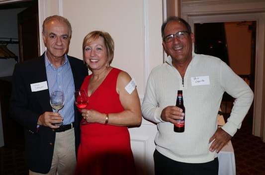 Debbie Hartman catches up with her friends, Steve DeNapoli and Bill Lopeito.