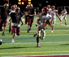 Tide junior running back Jaden Mahabir played a great game on offense as he outruns the BC High defense on a 19-yard TD run.