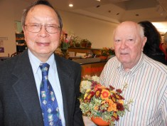 LAST YEAR'S HONOREES: Left to right, Attorney Nelson Chang and Veteran Town Meeting Member Bill Stewart, two of the recipients of the Readers Make Good Leaders Award for 2017, were among the crowd at the library Saturday night to congratulate this year's honorees.