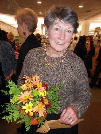 AWARDING THE BOUQUETS: Saugus Garden Club President Donna Manoogian holds one of several floral displays that went home with some lucky patrons.