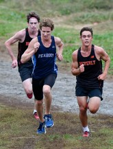 Ryan Buchanan of Peabody sprints towards the finish line during their cross country meet with Beverly at Brooksby Farm in Peabody on Wednesday, Oct. 3, 2018.