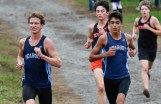 Ryan Buchanan, left, and Antonio Craveiro, right, of Peabody run the course side by side during their cross country meet with Beverly at Brooksby Farm in Peabody on Wednesday, Oct. 3, 2018.