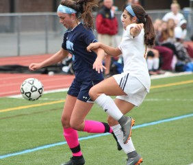 Peabody's Amber Kiricoples settles the ball while fending off a Cardinal Spellman defender in Monday's 2-1 win.