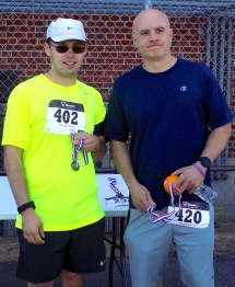 Christopher Rollins (left), 25, and Carl Champigny, 40, both of Peabody: Rollins finished in fifth place with a time of 21 minutes, 35 seconds and Champigny finished in fourth place with a time of 21 minutes, 21 seconds.