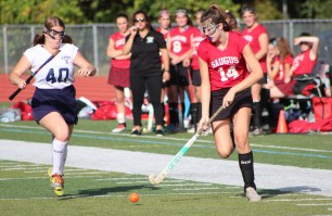 Saugus player Abby Ricciardelli gets to the ball ahead of Peabody defender Courtney Kline.