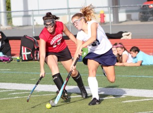 Peabody forward Sophie Izzo tries to stickhandle around Sachems' defender Maddy Claffey in action last Thursday. (Advocate photos by Greg Phipps)