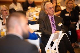 The Housing Families' financial accounts manager listens to the panel discussion at this week's Breaking Barriers Breakfast.