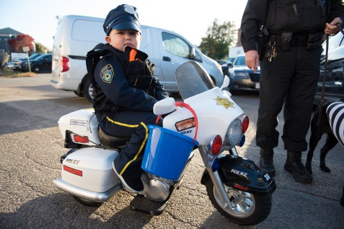 Jayden Castetter wore his police officer uniform to the Rec Center for Halloween, complete with motorcycle.