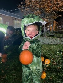 Revere resident Luke Porazzo, 3, was one of 599 residents to grab a pumpkin from the pumpkin patch at Mann's Garden Center at Rumney Marsh Academy on Sunday.