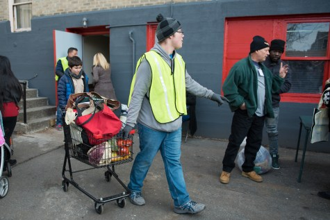 Dozens of volunteers helped out at the Grace Food Pantry to provide over 250 Thanksgiving dinners