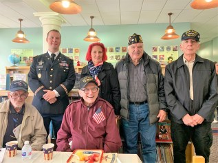 Shown during the City's Veterans Day ceremonies at the Paul Revere School last Thursday morning are, from left to right: World War II and Korea Veteran Charles Mackin; David Walker, who served in Afghanistan, the Persian Gulf and Jordan; caretaker Pamela Anderson; Jerry Ianniciello, who served in the Vietnam Era; World War II Veteran Morris Morris; and William Reedy, S4/62 U.S. Army. (Advocate photos by Tara Vocino)