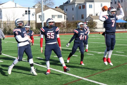 It's All Over! 18-6 Patriots, #7 Jonathan Murphy leads his team mates off the field as time runs out for the Vikings. Shown Cal Capozzi, Capt. Frank Simms, Yussuf Ali Budah.