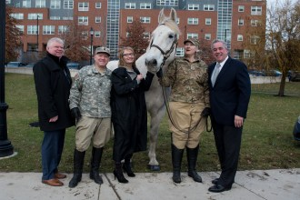 Mayoral Chief of Staff Kevin O'Donnell, Master Sergeant Paul Tobin, Horses and Heroes Foundation Founder Skyllar Mullvaney, Private Raquel McComas and State Representative Joe McGonagle took part in the ceremony to present the horse Everett Strong.