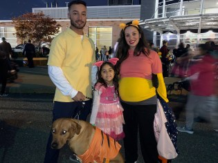 The Tango family dressed up as the Winnie the Pooh clan for Sunday's Fright Night at Rumney Marsh Academy. From left to right, Devin Tango (Christopher Robin), Isabella (Piglet), Jennifer (Winnie the Pooh) and Argo (Tigger).
